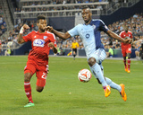 Mar 15, 2014 - MLS: FC Dallas vs Sporting KC - C.J. Sapong, Kellyn Acosta Photo by Peter Aiken