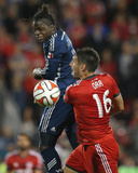 Jul 16, 2014 - MLS: Vancouver Whitecaps vs Toronto FC - Darren Mattocks, Bradley Orr Photo by Tom Szczerbowski