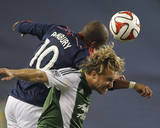 Aug 16, 2014 - MLS: Portland Timbers vs New England Revolution - Teal Bunbury, Michael Harrington Photo by Stew Milne