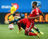 Aug 2, 2014 - MLS: Toronto FC vs Montreal Impact - Troy Perkins, Luke Moore Photo by Jean-Yves Ahern