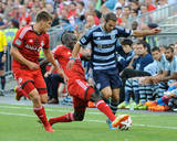 Jul 26, 2014 - MLS: Sporting KC vs Toronto FC - Dominic Oduro, Nick Hagglund Photo by Peter Llewellyn