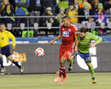 2014 MLS Playoffs: Nov 10, FC Dallas vs Seattle Sounders - Tesho Akindele, Zach Scott Photo by Steven Bisig
