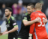 Apr 5, 2014 - MLS: Seattle Sounders vs Portland Timbers - Andrew Weber, Clint Dempsey Photo by Steven Bisig