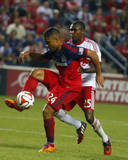 Aug 10, 2014 - MLS: New York Red Bulls vs Chicago Fire - Quincy Amarikwa, Chris Duvall Photo by Dennis Wierzbicki