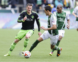 Apr 5, 2014 - MLS: Seattle Sounders vs Portland Timbers - Kenny Cooper, Norberto Paparatto Photo by Steven Bisig