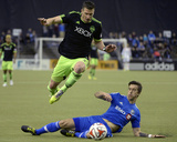 Mar 23, 2014 - MLS: Seattle Sounders vs Montreal Impact - Kenny Cooper, Jeb Brovsky Photo by Eric Bolte