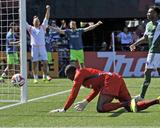Aug 24, 2014 - MLS: Seattle Sounders vs Portland Timbers - Donovan Ricketts, Chad Barrett Photo by Susan C. Ragan