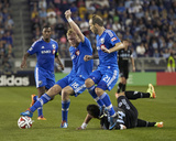 Apr 19, 2014 - MLS: Montreal Impact vs Sporting KC - Calum Mallace, Dom Dwyer Photo by Gary Rohman
