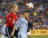 Apr 26, 2014 - MLS: Sporting KC vs New England Revolution - Eric Kronberg, Dom Dwyer Photo by Stew Milne