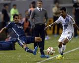 Aug 23, 2014 - MLS: Vancouver Whitecaps vs Los Angeles Galaxy - Mehdi Ballouchy, A.J. DeLaGarza Photo by Kelvin Kuo