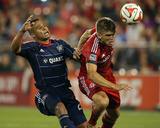 Aug 23, 2014 - MLS: Chicago Fire vs Toronto FC - Quincy Amarikwa, Nick Hagglund Photo by Tom Szczerbowski