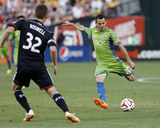 Jun 28, 2014 - MLS: Seattle Sounders vs D.C. United - Marco Pappa, Bobby Boswell Photo by Geoff Burke