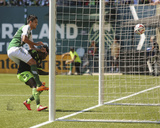 Aug 24, 2014 - MLS: Seattle Sounders vs Portland Timbers - Obafemi Martins, Norberto Paparatto Photo by Jaime Valdez