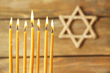 Hanukkah Candle on Wooden Background Photographic Print by  Yastremska