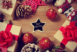 A Pile of Gifts and Christmas Ornaments, such as Christmas Balls and Stars, on a Rustic Wooden Tabl Prints by  nito
