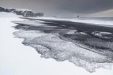 Iceland , South Iceland, Dyrholaey, Snowy Beach of Dyrholaey Photographic Print by Salvo Orlando