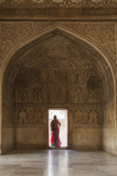 India, Uttar Pradesh, Agra, Agra Fort, a Woman in a Red Saree Walks Through the Interior Photographic Print by Alex Robinson