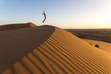 Oman, Wahiba Sands. Tourist Jumping on the Sand Dunes (Mr) Photographic Print by Matteo Colombo