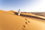 Oman, Wahiba Sands. Bedouin on the Sand Dunes at Sunset (Mr) Photographic Print by Matteo Colombo
