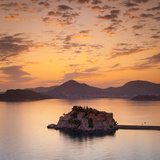 The Picturesque Island Village of Sveti Stephan Illuminated at Sunset, Sveti Stephan, Montenegro Photographic Print by Doug Pearson
