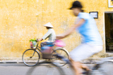 Vietnam, Hoi An. Local People on Bicycle in the Streets of the Town Photographic Print by Matteo Colombo