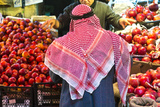 Arab Man Waerinf Keffiyeh Buying Apples in Market, Amman, Jordan Photographic Print by Peter Adams