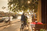 Cyclos Passing Restaurant, Hoi an (Unesco World Heritage Site), Quang Ham, Vietnam Photographic Print by Ian Trower