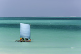 Madagascar, Salary, a Pirogue Sailing in the Blue Sea Photographic Print by Roberto Cattini