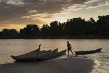 Madagascar, Beopaka, Pirogues at Dusk on Manambolo River Photographic Print by Roberto Cattini