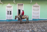 Cuba, Trinidad, Milkman on Horseback Delivers Bottles of Milk to House Photographic Print by Jane Sweeney