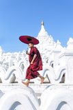 Myanmar, Mandalay Division, Mingun. Novice Monk with Red Umbrella Jumping on Hsinbyume Pagoda (Mr) Photographic Print by Matteo Colombo