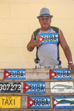 Cuba, Trinidad, Man Selling Cuban Car Number Plates Photographic Print by Jane Sweeney