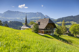 Jon Arnold - Church and Farmhouse in a Village in the Emmental Valley, Berner Oberland, Switzerland Fotografická reprodukce