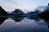 New Zealand, Nuova Zelanda, Fiordland, Milford Sound and Moon During a Cold and Misty Sunrise. Photographic Print by Andrea Pozzi
