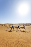 Oman, Wahiba Sands. Tourists Riding Camels in the Desert (Mr) Photographic Print by Matteo Colombo
