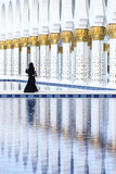 United Arab Emirates, Abu Dhabi. Arabic Woman Walking Inside Sheikh Zayed Grand Mosque Photographic Print by Matteo Colombo