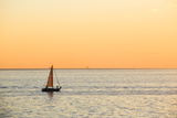 Italy, Friuli Venezia Giulia, Trieste, Boat at Sunset Photographic Print by Andrea Pavan