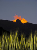 Fiery Sunlight and Clouds Upon Huascaran Mountain, with Wheat Growing in the Foreground Photographic Print by Diane Cook Len Jenshel