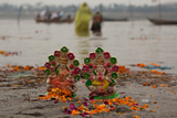 Puja or Prayers, and Offerings are Left on the Banks of the Ganges River During Kumbh Mela Photographic Print by Greg Davis