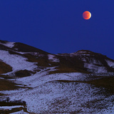 The Total Lunar Eclipse of December 2011 over the Snowy Zagros Mountains Photographic Print by Babak Tafreshi