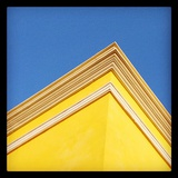 The Corner of a Yellow Building Against a Clear Blue Sky Photographic Print by Andrew Evans