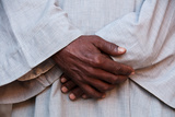 Hands of an Attendant at the Edfu Temple on the Nile River Photographic Print by Karen Kasmauski