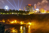 The Niagara River at Niagara Falls and the Attractions on the Far Shore at Night Photographic Print by Babak Tafreshi