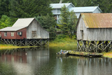 Houses Built on Stilts Rise Above a Tidal Waterway in Petersburg, Alaska Photographic Print by Jonathan Kingston