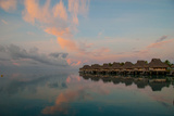 Vacation Cottages over the Lagoon on the Island of Bora Bora at Dawn Photographic Print by Karen Kasmauski