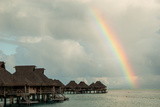 A Rainbowover the Ocean and Vacation Cottages on Bora Bora Photographic Print by Karen Kasmauski
