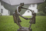 A Sculpture of a Woman and Child Dancing, on a Rainy Day Photographic Print by Ulla Lohmann