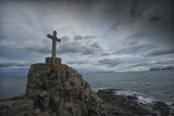 A Stone Cross Atop a Coastal Rock Outcropping in Iceland Photographic Print by Keith Ladzinski