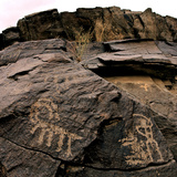 Ancient Petroglyphs Dating Back 4,500 to 17,000 Years Ago Photographic Print by Babak Tafreshi