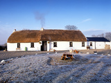 Crabtree Cottage, a Traditional Irish Thatched Cottage Photographic Print by Chris Hill